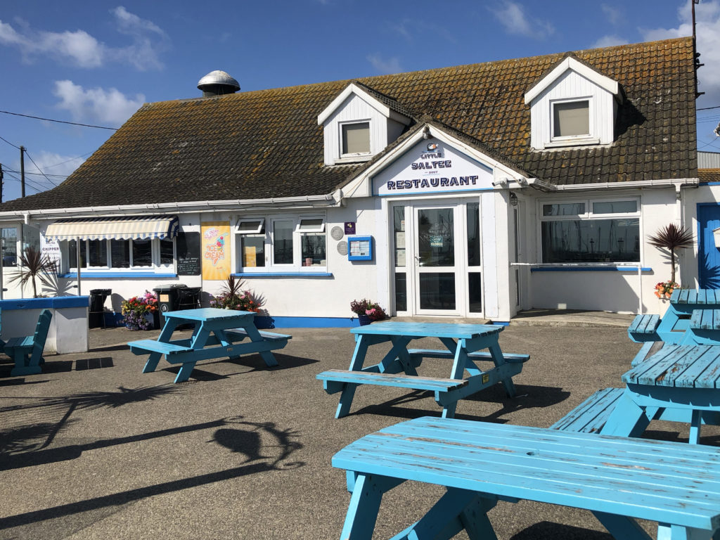 Enjoy the Summer sunshine at one of our blue tables!